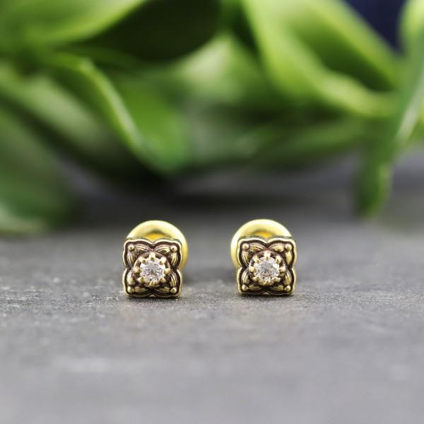 Goldene Ohrringe in orientalischer Optik mit Swarovskisteinen