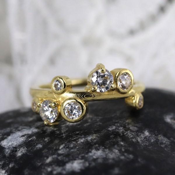 Clicker aus 18 Karat Echtgold mit großen Swarowskisteinen