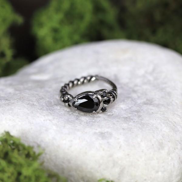 Clicker mit großen Glitzersteinen und gekordeltem Ring